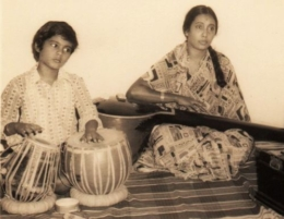 2. Accompanying his mother on the tabla